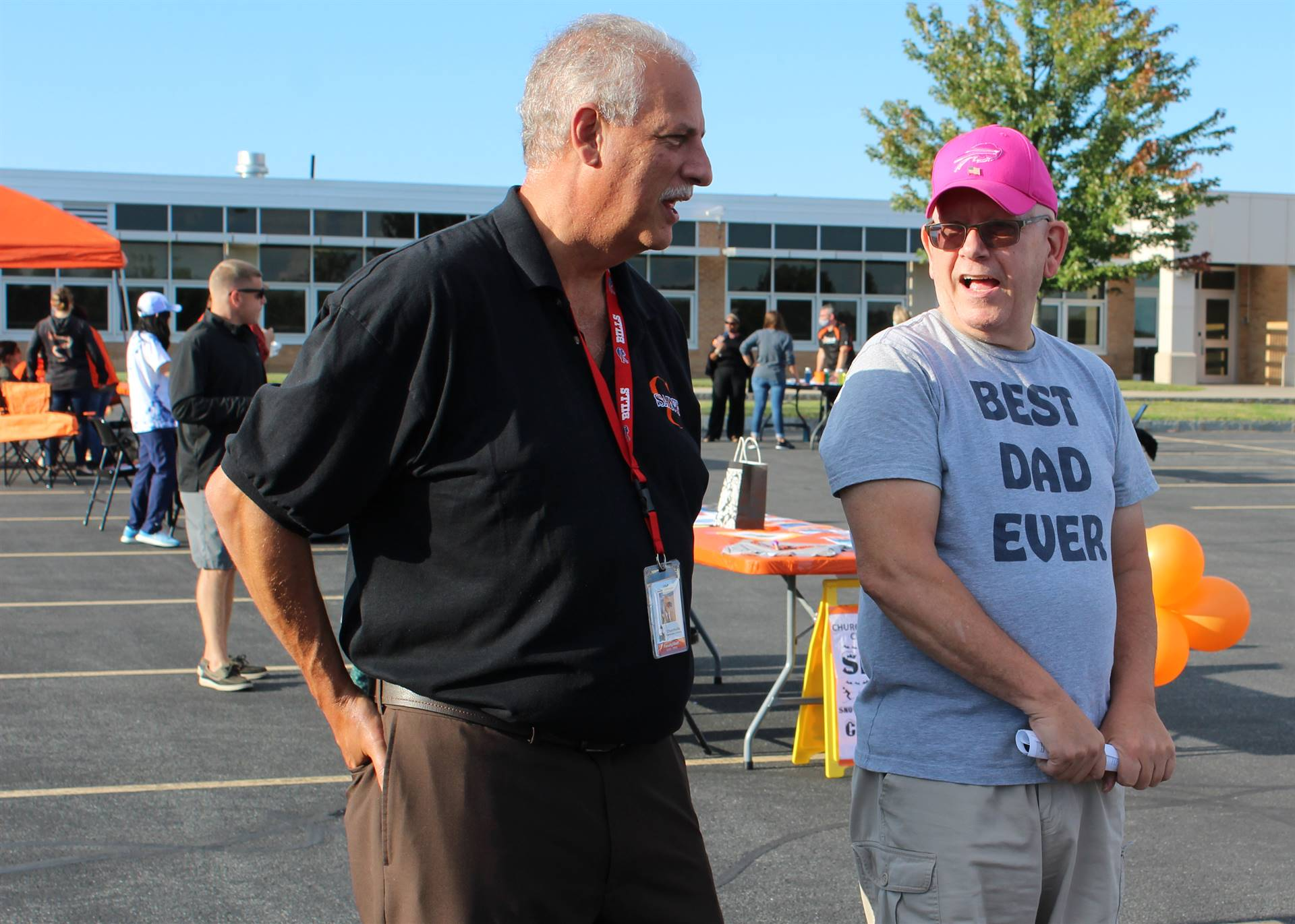 CES principal speaking with a dad