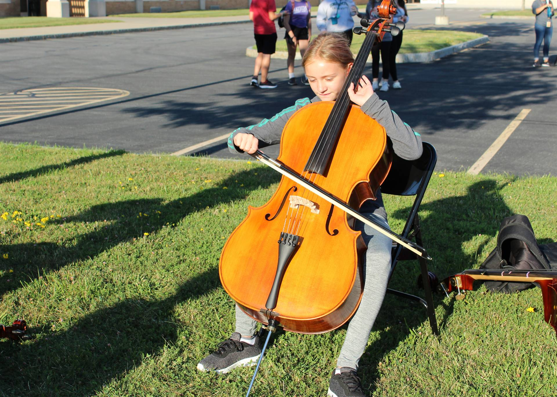 Student trying an instrument