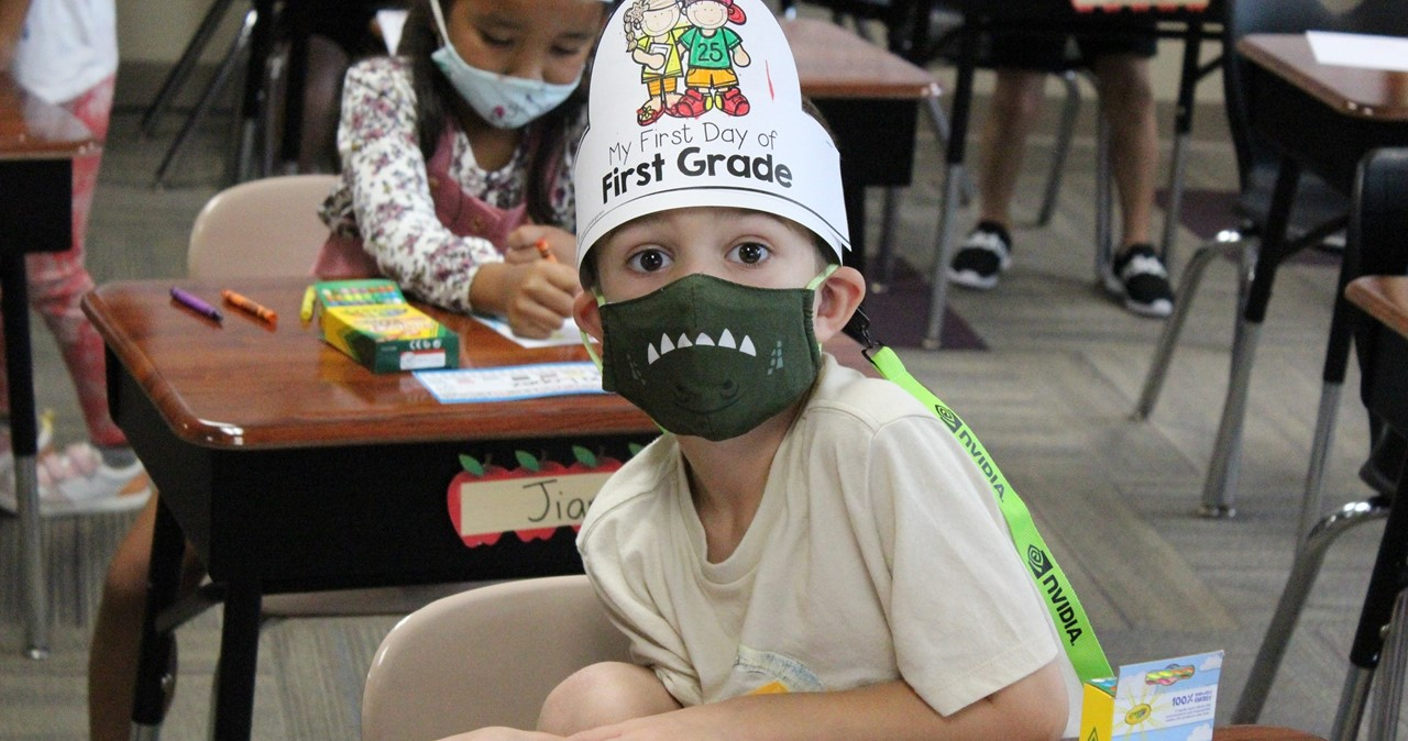 First-grader wearing mask with scary teeth