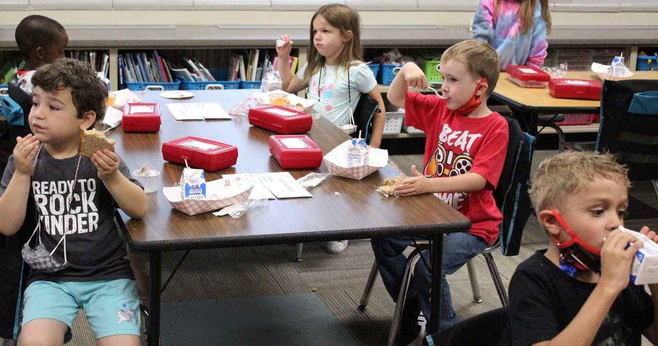 Group of students in the classroom having a snack