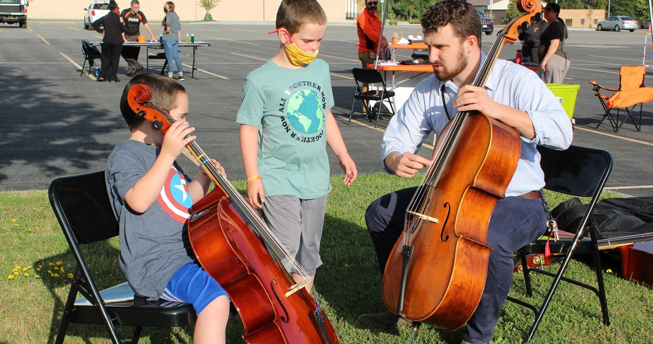 Students trying out musical instruments at Celebrate