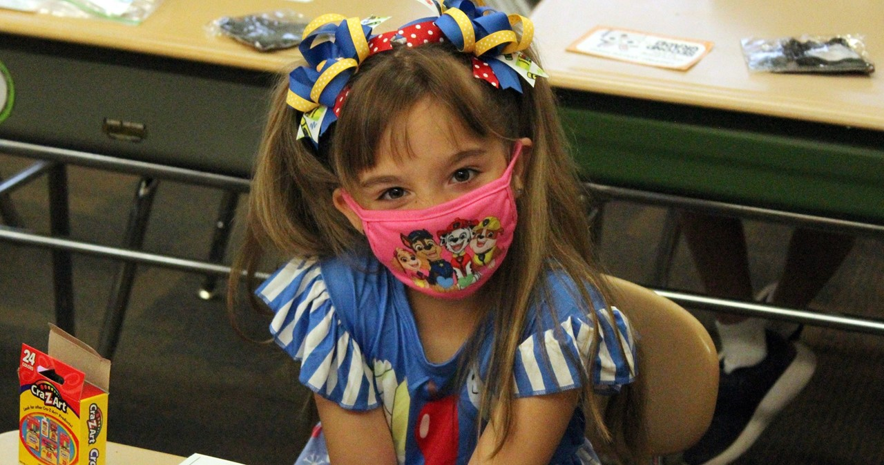 CES 2nd-grader with brightly-colored hair ribbons
