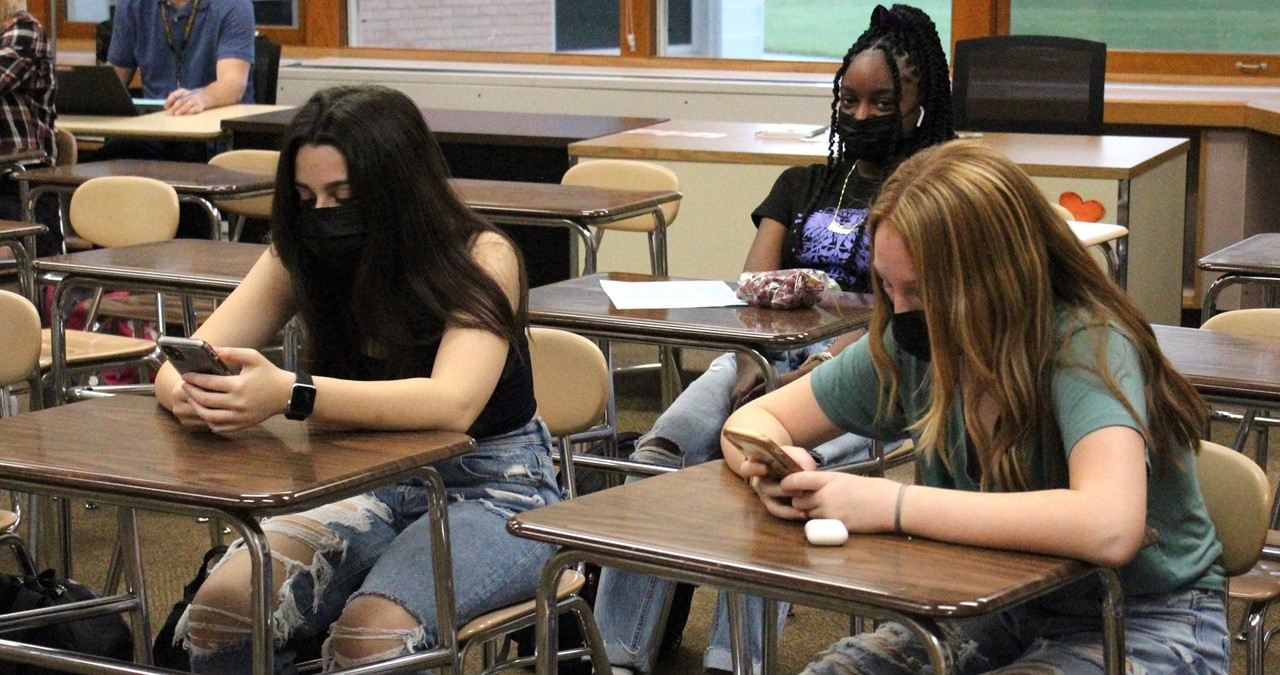 Students looking at their cell phones