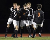 Boys Varsity Soccer Players celebrating a goal in Sectionals